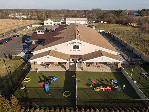 a bird's eye view of a luxury pet hotel, Golden Paws Pet Resort & Spa, located in Mercer County, NJ